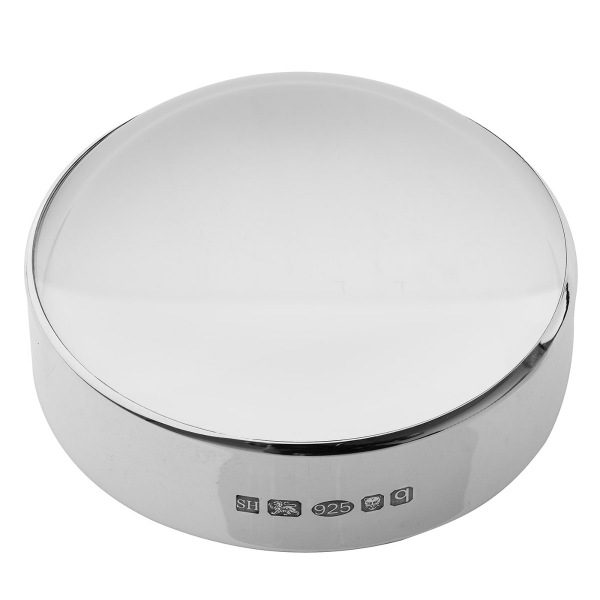Silver magnifying paperweight
