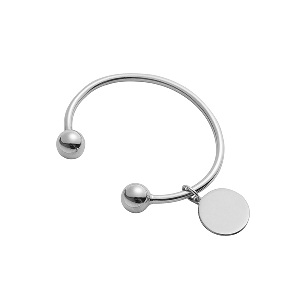 Silver torque bangle with disc charm
